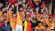 Castlebar Mitchels's Rory Byrne lifts the cup