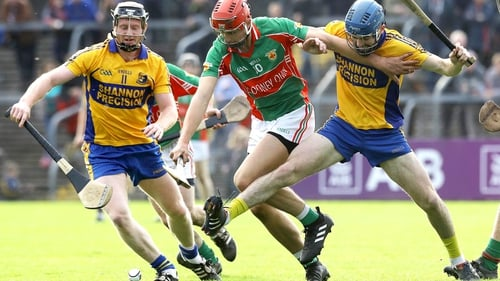 Clooney-Quin's Peter Duggan is tackled by Jamie Shanahan and Alex Morey of Sixmilebridge