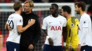 Jurgen Klopp hugs Harry Kane, who scored twice against Liverpool