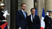 French President Emmanuel Macron (R) welcomes Leo Varadkar upon his arrival at the Elysee Palace in Paris