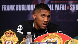 Former Olympic champion Anthony Joshua squared up to Jarrell Miller during his meet with Alexander Povetkin after the American invaded the stage.