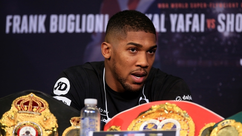 Anthony Joshua speaking at a press conference ahead of his fight with Carlos Takam