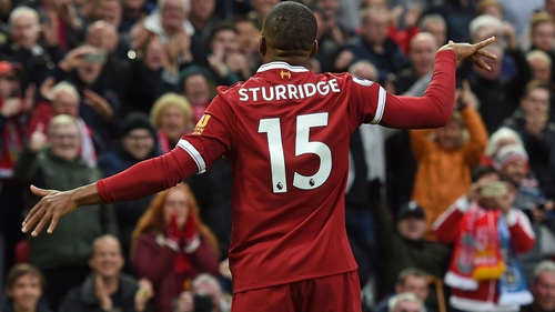Daniel Sturridge celebrates his well-taken goal against Huddersfield Town at Anfield