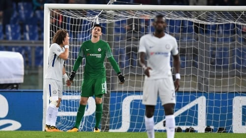 Thibaut Courtois and David Luiz argue after Roma's second goal