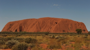The UNESCO World Heritage-listed 348m high rock, known for its shifting red-ochre colours, is a top tourist site