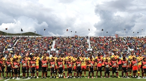 Papua New Guinea embrace for their national anthem