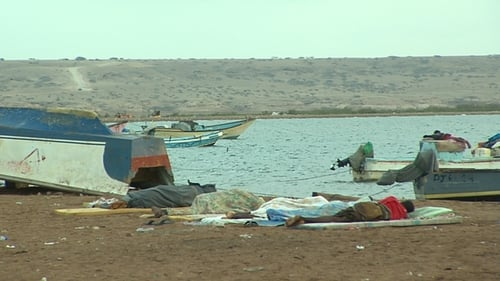 People sleep on the beach in Obock while they wait for a chance to reach Yemen