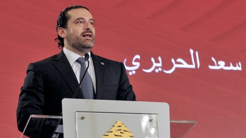 After resignation and extended absence Hariri leaves Cairo for home