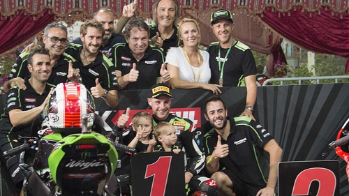 Jonathan Rea celebrates victory with his team and family
