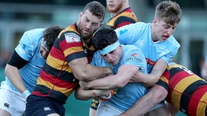 Lansdowne's Charlie Butterworth is tackled by Peadar Collins of Garryowen