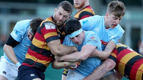 Lansdowne's Charlie Butterworth is tackled by Peadar Collins of Garryowen