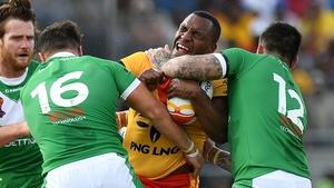 Enock Maki of Papua New Guinea takes on the Irish defence