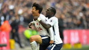 Heung-Min Son celebrates his goal against Crystal Palace with  Moussa Sissoko.
