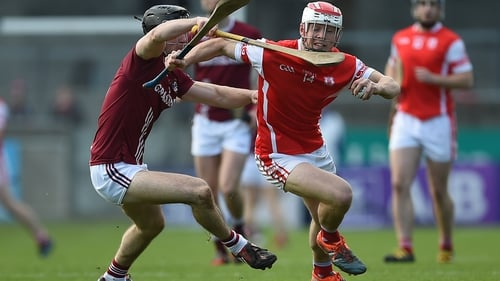 Evan Cody (L) attempts to tackle  Cuala's Con O'Callaghan