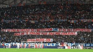The banners read: 'You thought you were above the institution OM and its supporters. We don't want you in our colours anymore. Evra get lost!'