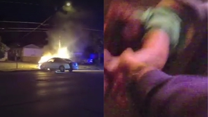 Watch as hero police officer pulls a woman from a burning car