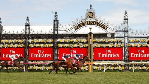 Jockey Corey Brown rides Rekindling to win the Melbourne Cup