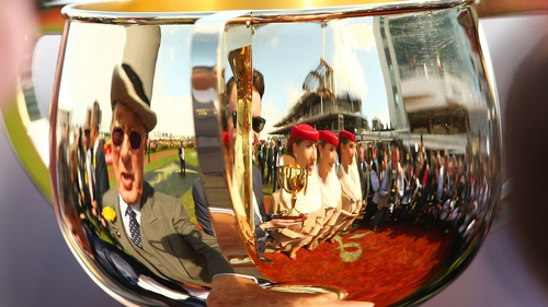 Owner Lloyd Williams (L) and trainer Joseph O'Brien (C) are reflected in the Melbourne Cup
