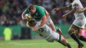 Tadhg Furlong carries hard against South African scrum-half Faf de Klerk last year