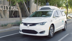 A Waymo self-driving people carrier being tested on a public road in California.