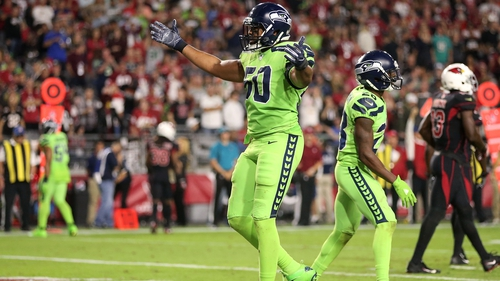 Outside linebacker K.J. Wright of the Seattle Seahawks celebrate a turnover against the Cardinals