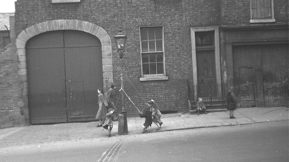 Children Playing Dublin Lamp Post