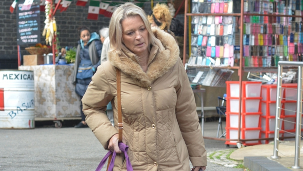 Kathy Beale tries to flee Walford after dark secret is revealed
