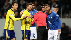 Things get hot and heavy during Sweden's play-off first-leg clash with Italy