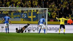 Gianluigi Buffon watches the ball go past him after a big deflection