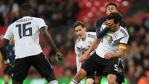 Sebastian Rudy and Mats Hummels of Germany battle for possession with Jesse Lingard