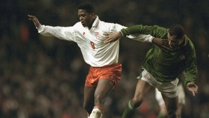 Patrick Kluivert and Paul McGrath battle for possession in the Euro 96 play-off