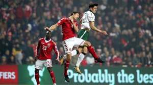 Callum O'Dowda rises with Thomas Delaney of Denmark