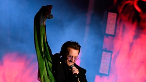 Bono tossed an Irish flag into the crowd
