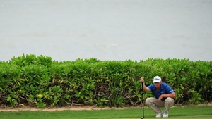Patton Kizzire of the United States lines up a putt on the 15th green