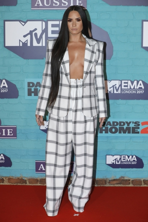Styled by 'Image Architect' Law Roach, Demi wore this daring Styland suit.