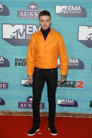 Liam Payne kept it casual before his EMA performance in black jeans and an orange jacket.