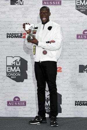 Worldwide Act award winner Stormzy poses in the winner's room.