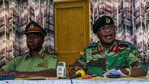 Army chief Constantino Chiwenga (R) has openly threatened to intervene in Zimbabwe's politics