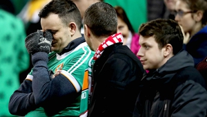 Republic of Ireland fans disconsolate after watching their team lose heavily to the Danes