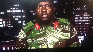 Major General Sibusiso Moyo, Chief of Logistics of the Zimbabwean army, addresses the nation on ZBC. Photo: Getty Images