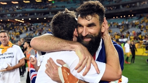 Australia's Robbie Kruse and Mile Jedinak (R) embrace