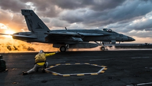 F/A-18E Super Hornet launching from the flight deck of the aircraft carrier USS Ronald Reagan