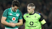 Carbery is helped from the field