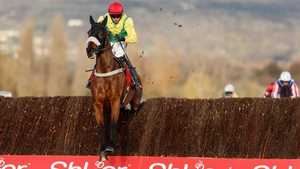 Bryan Cooper riding Fox Norton clears the last to win The Shloer Steeple Chase at Cheltenham