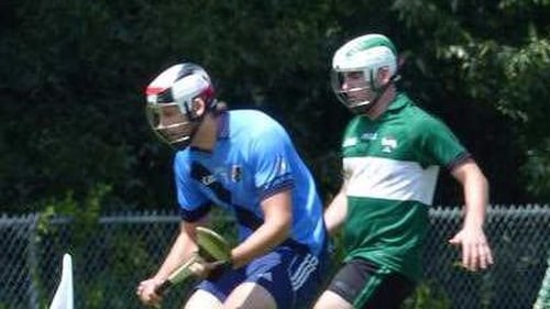 Michael Walsh (R) formed a hurling club in America