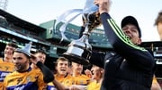 Clare players celebrate with the trophy