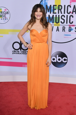 Bad Moms actress Kathryn Hahn was glowing in this orange floor-length gown and loose curls.