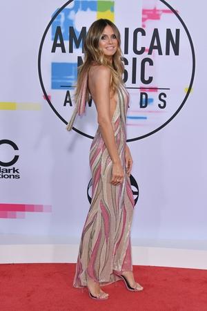 Heidi Klum wore a Gianni Versace dress with Giuseppe Zanotti heels