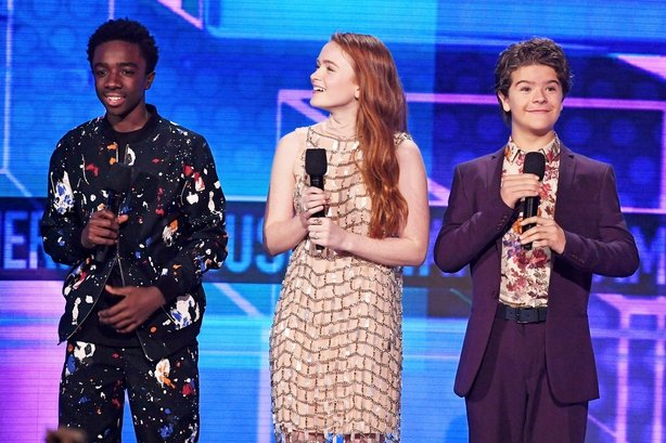 Caleb McLaughlin, Sadie Sink, and Gaten Matarazzo speak onstage during the 2017 American Music Awards