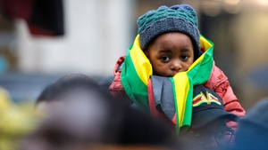 A child at a protest against Robert Mugabe's continued rule